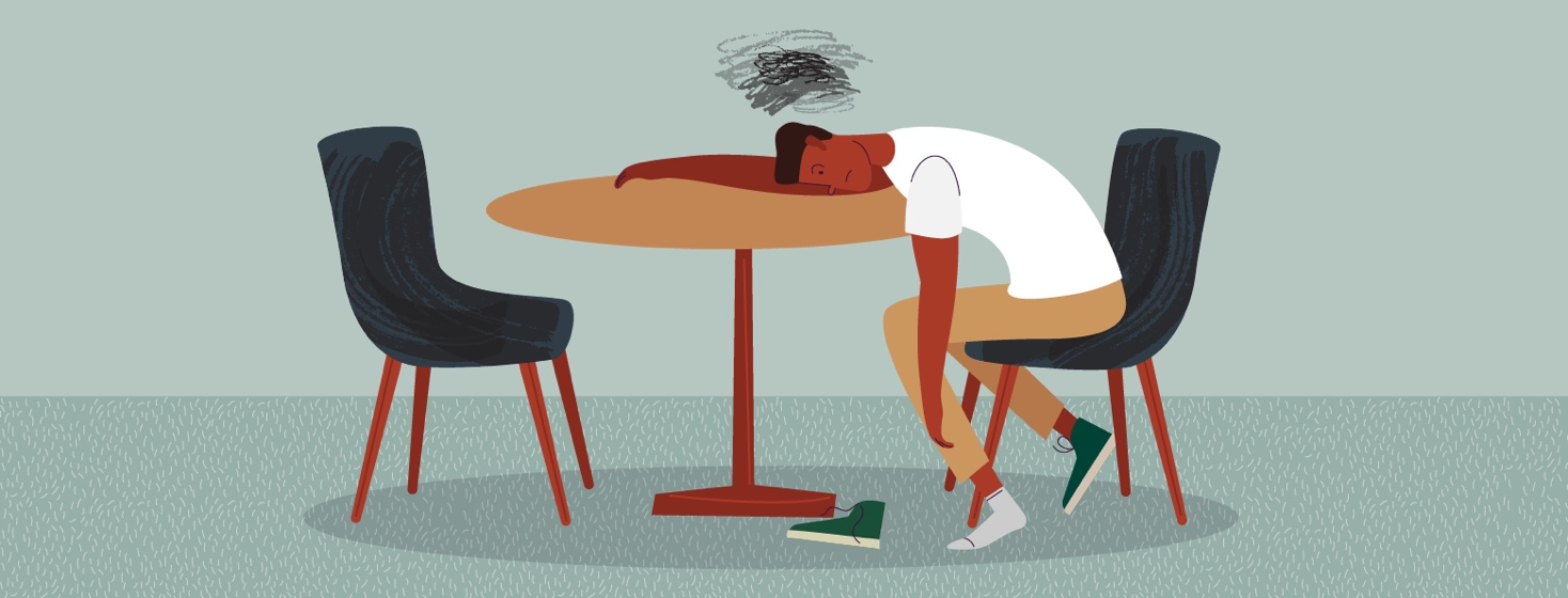 Person sitting with head on table tired (cloud above head)