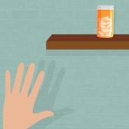Hand reaching for pills on a higher shelf