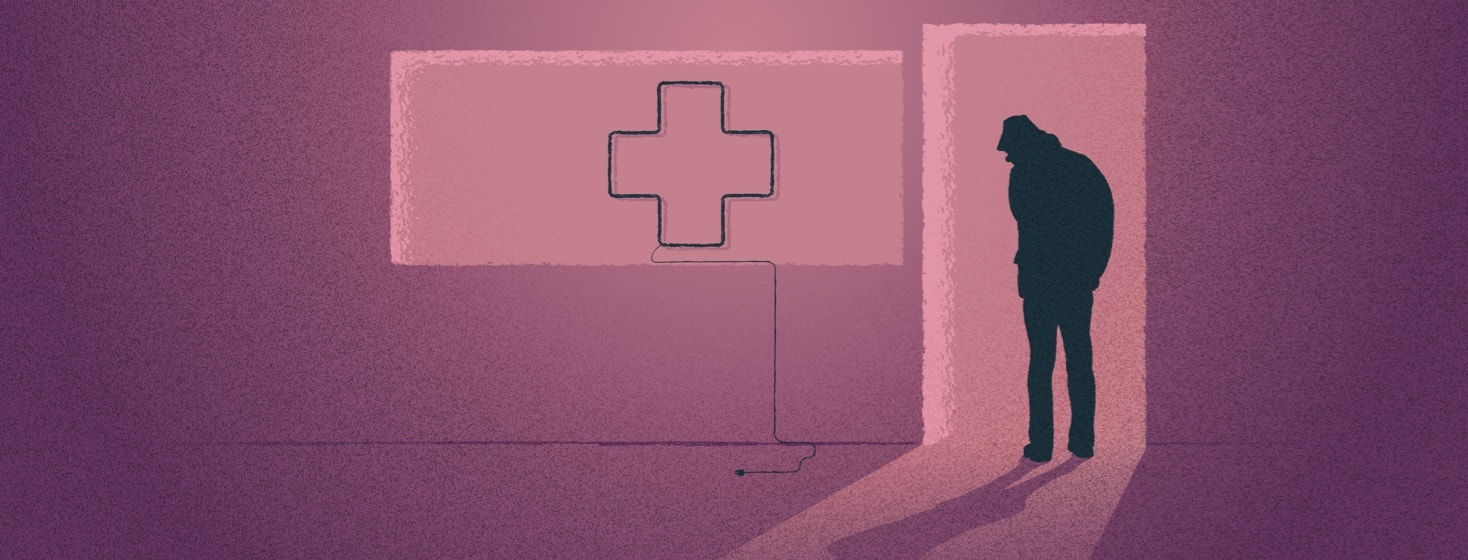 A silhouette of a doctor walking through a door looking at an unplugged neon light in the shape of a medical cross.