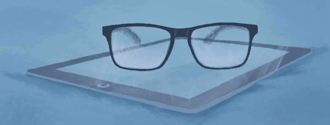 Blue Light glasses sitting on top of a tablet