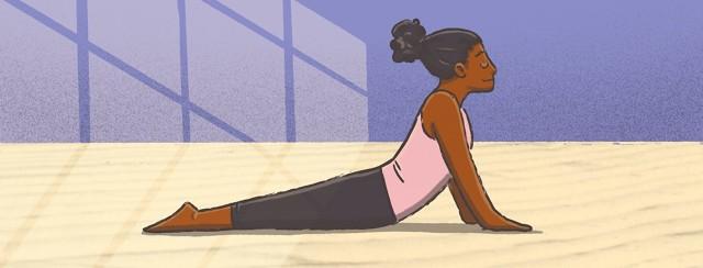 Woman doing yoga in a peaceful sun lit room.
