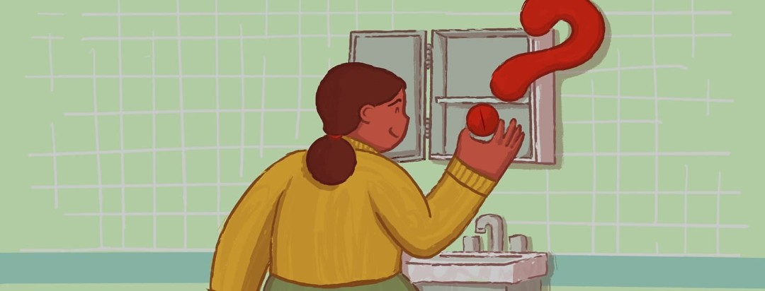 A woman holding an oversized pill/tablet that is part of a question mark. She is standing in her bathroom looking optimistically in a medicine cabinet.