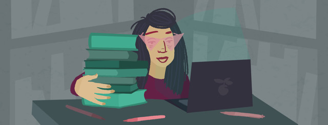 Person with rose tinted glasses that block out laptop light sits in library holding pile of books.