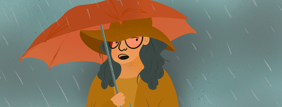 Person with umbrella in rain tries disguising self with Theraspecs and floppy hat.
