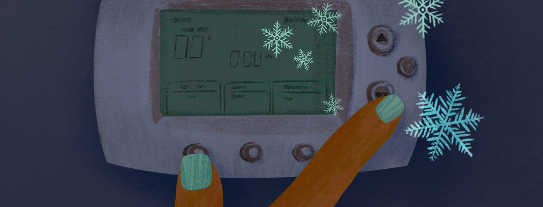 Person adjusts thermostat down to icy cold snowflake temperatures