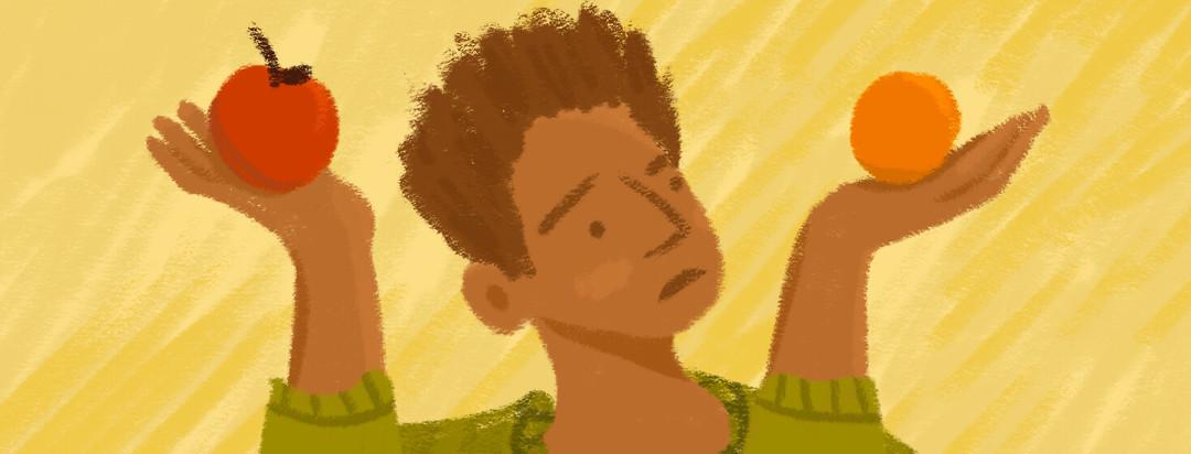 Black man shrugs holding apple and orange in each hand