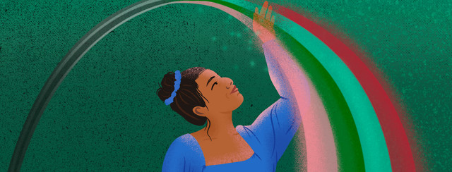 Filipino woman with hair tied in bun lifts hand to touch rainbow that faded from black and white behind her to full color before her.