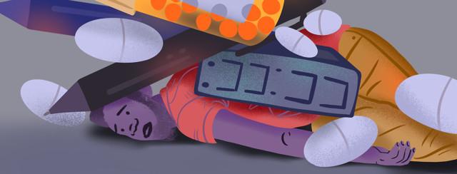 Man lays flat under deluge of pills, alarm clock, pens, medication bottle