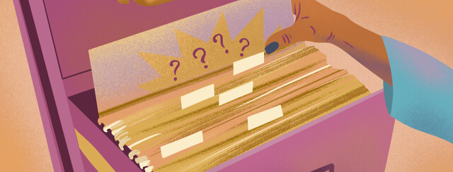 Hand flips through filing cabinet, pulling file with question marks