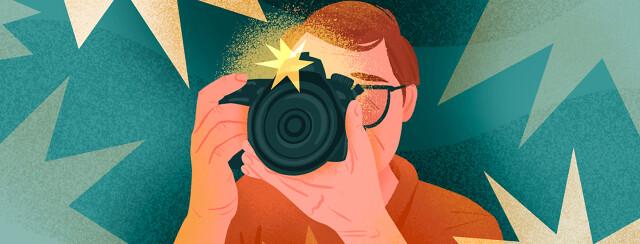 Man behind camera with flashing stars surrounding him