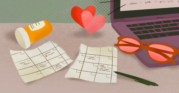 Desk featuring ripped up schedule, rose-tinted glasses, laptop with hearts, pill bottle