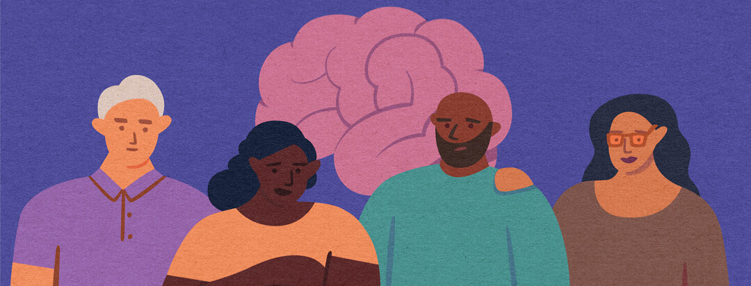 Four adults stand together with brain behind them