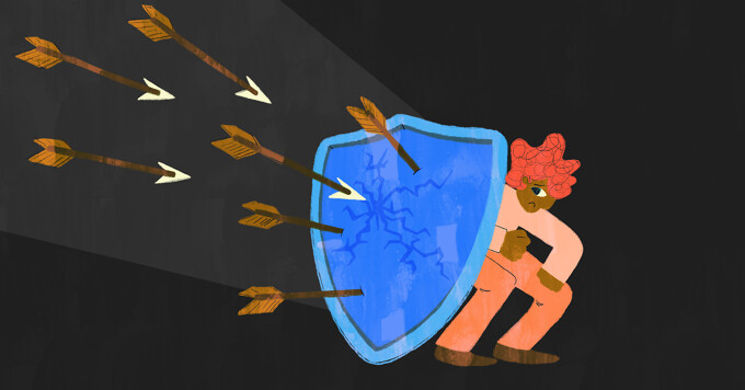 Person cowers behind shield with arrows flying toward it