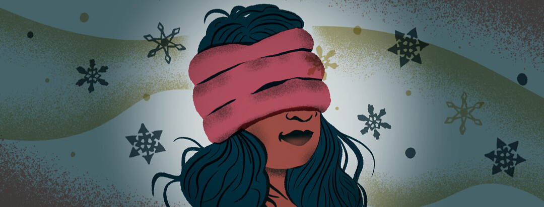 Woman's head covered by a cold headache hat with snowflakes surrounding her