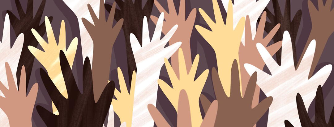 Hands of different skin colors raised in a group